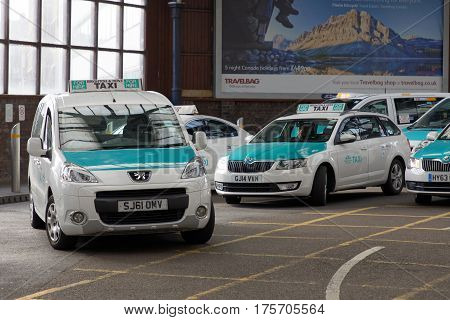 BRIGHTON GREAT BRITAIN - MAR 01 2017: Taxi station outside the train station in Brighton UK. March 01 2017 in Brighton Great Britain