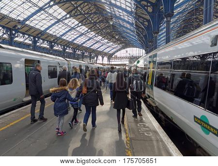 BRIGHTON GREAT BRITAIN - FEB 24 2017: Group of people leaving the train in the train station in Brighton UK. February 24 2017 in Brighton Great Britain