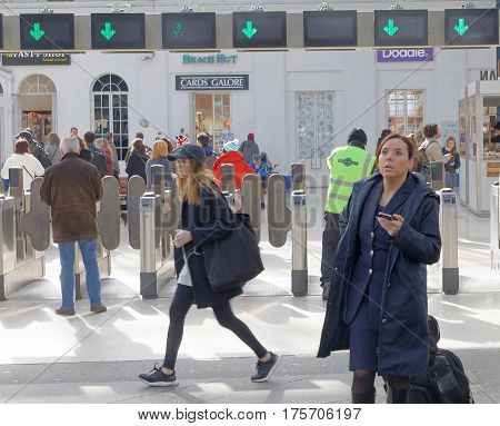 BRIGHTON GREAT BRITAIN - FEB 24 2017: People waiting for the train in the train station in Brighton UK. February 24 2017 in Brighton Great Britain