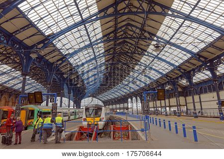BRIGHTON GREAT BRITAIN - MAR 01 2017: Trains and workers in the beautiful old train station in Brighton UK. March 01 2017 in Brighton Great Britain