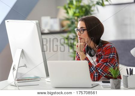 Young woman programmer working at office