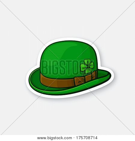 Vector illustration. Green bowler hat with clover. Saint Patrick's Day symbol. Sticker in cartoon style with contour. Decoration for greeting cards, patches, prints for clothes, badges, posters, emblems