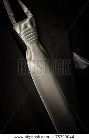 Wedding suit jacket of groom's man. Detail tie wedding.