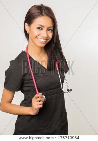 Happy smiling cheerful nurse with a stethoscope