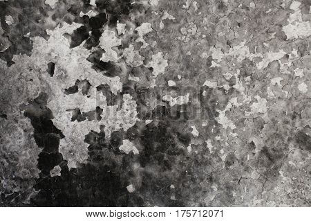 Burned wall texture. Burned wall background. Detail of a wall destroyed by fire. Abstract background and texture for designers. Close up view of burned wall. Grunge wall.