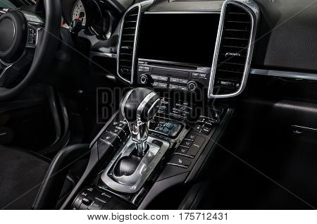 Black luxury car Interior - shift lever and dashboard.