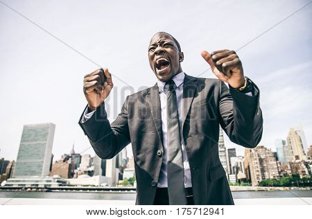 Confident happy businessman exulting in New York