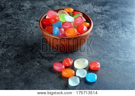 Different cough drops on color background