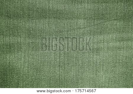 Green texture of jeans textile close up. Blank backdrop for design. Multicolor background set.