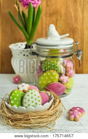 Easter cookies on wooden background.
