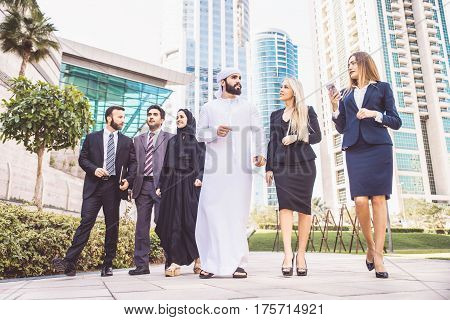 Multiethnic group of businesspeople meeting outdoors in a modern city