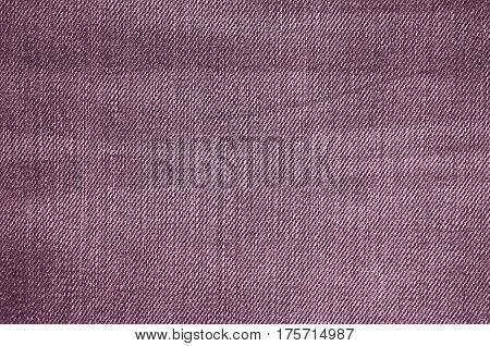 Purple texture of jeans textile close up. Blank backdrop for design. Multicolor background set.