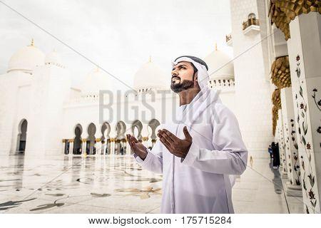 Arabian man at Sheikh Zayed Grand Mosque in Abu Dhabi United Arab Emirates.