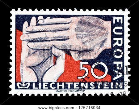 LIECHTENSTEIN - CIRCA 1962 : Cancelled postage stamp printed by Liechtenstein, that shows Hands.