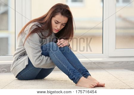 Despaired young woman indoors