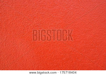 Warm tone red cement wall background clean vintage style and empty space for text For web design or graphic art image and photography studio backdrop .
