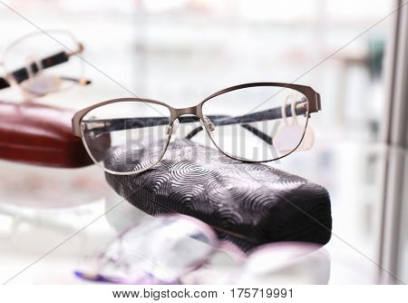 Shelf with glasses and spectacle-case in shop