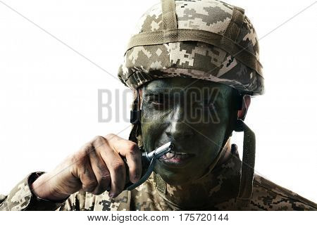 Close up view of soldier pulling safety pin out of fragmentation grenade, on white background