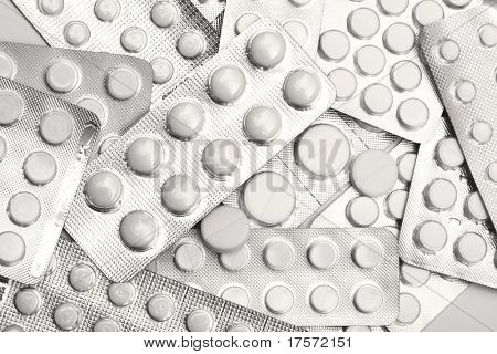 heaps of packs of white tablets