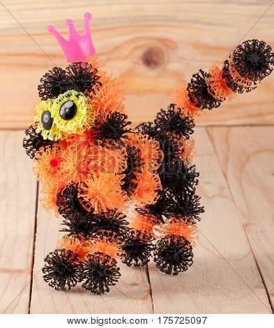 tiger from elements of children's designer of Velcro on a wooden background.