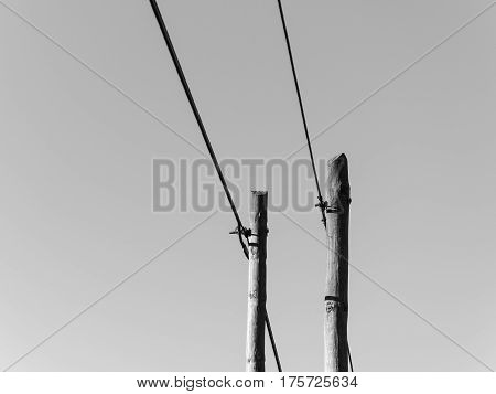 an old fashion pole with cables and wires symbol of communication and internet