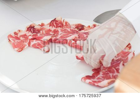 Fresh Slice Of Ham Served With Sterile Gloves