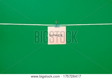 Pink Paper Note On Clothesline With Text Summer