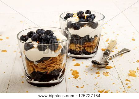 traditional scottish dessert cranachan with blueberries and corn flakes