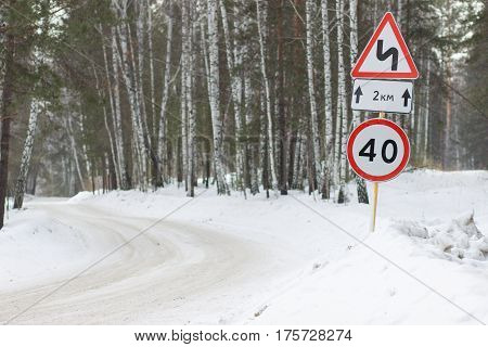 Speed limit on a winding forest road for 2 kilometers
