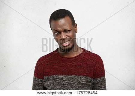 Human Facial Expressions, Emotions And Feelings. Studio Shot Of Disgusted Young African American Man