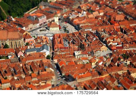 Aerial view of Brasov city in Transylvania Romania. Tilt shift lens effect