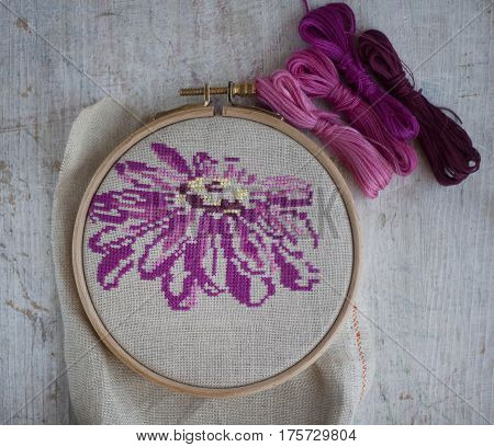 beautiful bright flower embroidered cross-stitch in the Hoop rustic still life