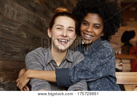 Sweet Shot Of Happy Cheerful Interracial Gay Couple Enjoying Their Free Love, Cuddling And Hugging E