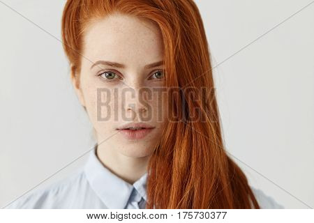 Beauty And Hair Care Concept. Close Up Shot Of Beautiful Redhead Girl With Perfect Clean Skin With F