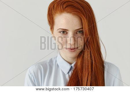 Portrait Of Gorgeous Young European Female Student With Freckles Wearing Her Long Ginger Hair On The
