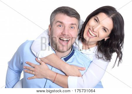 Portrait of a happy young couple on a white background