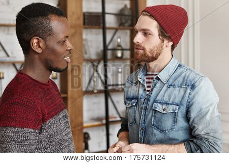 People And Interracial Friendship Concept. Candid Shot Of Two Stylish Male Best Friends Of Different