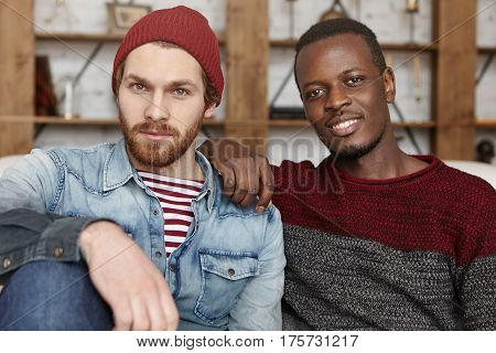 Male Bonding. Cheerful Happy Young Caucasian And African Friends Wearing Stylish Clothing Talking, H