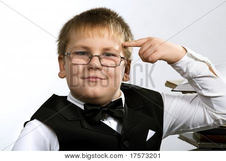 Funny school boy thinking. Isolated over white