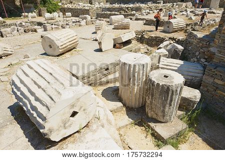 BODRUM, TURKEY - AUGUST 15, 2009: Unidentified people visit ruins of the Mausoleum of Mausolus one of the Seven wonders of the ancient world in Bodrum, Turkey.