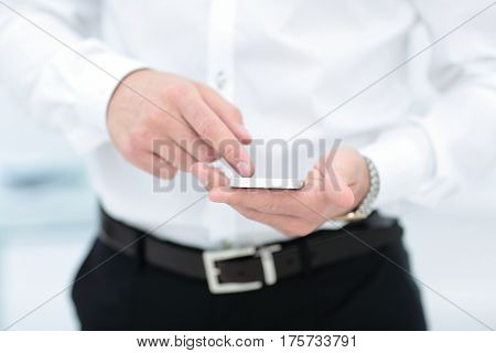 Mock up of a man holding device and touching screen