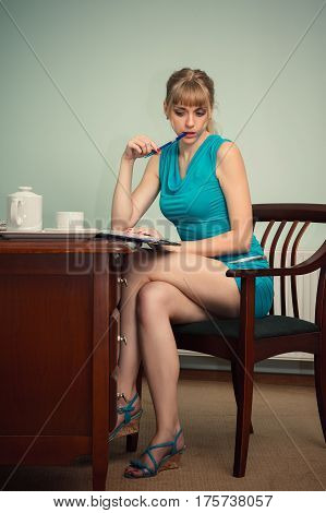 beautiful sexy businesswoman sitting at the table