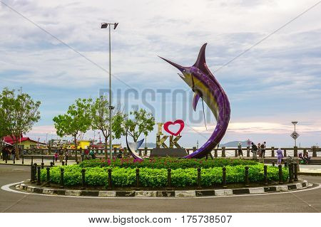 Kota Kinabalu,Sabah-Feb 28,2017:The famous Marlin statue &  landmark I Love KK during sunset in roundabout in the middle of Kota Kinabalu city.It is the one that tourist usually take picture with it on 27th Feb 2017