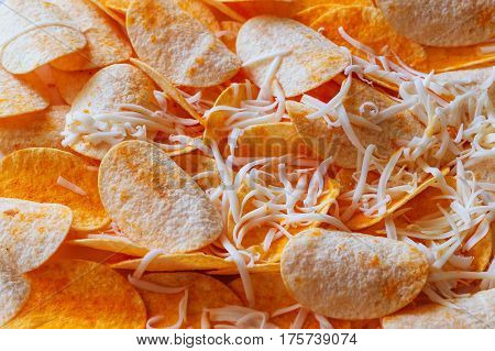 Chips Pattern. Yellow Salted Potato Chips As Background. Chips Texture Photo.