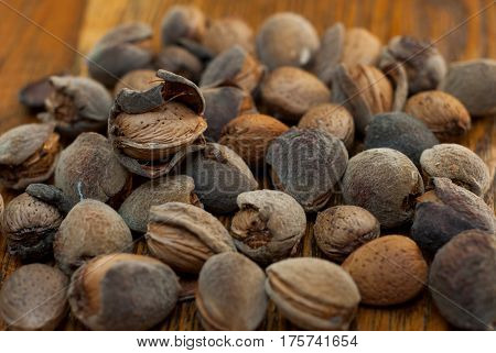 photo of raw almonds on the wooden background