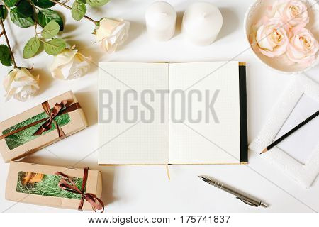 Opened empty diary, pen, vintage tray, roses on white background. Flat Lay, top view, mockup