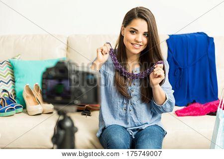 Woman Recording A Fashion Video Blog