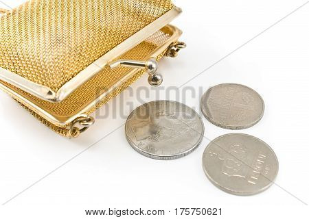 Golden purse with old european coins isolated on white