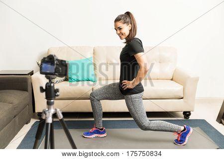Fitness Blogger Demonstrating An Exercise