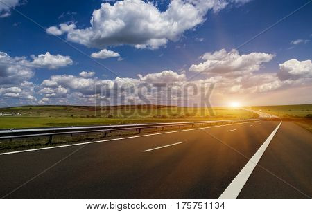 Highway traffic in sunset with cars and trucks